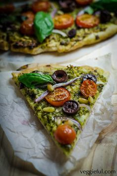 VEGAN PESTO PIZZA Makes two 30cm diameter pizzas. Sauce • 3 garlic cloves • 2 tablespoons nutritional yeast • 1/3 cup pine nuts • 4 cups basil leaves • 1/2 small lemon, juiced • 1/3 cup olive oil •...
