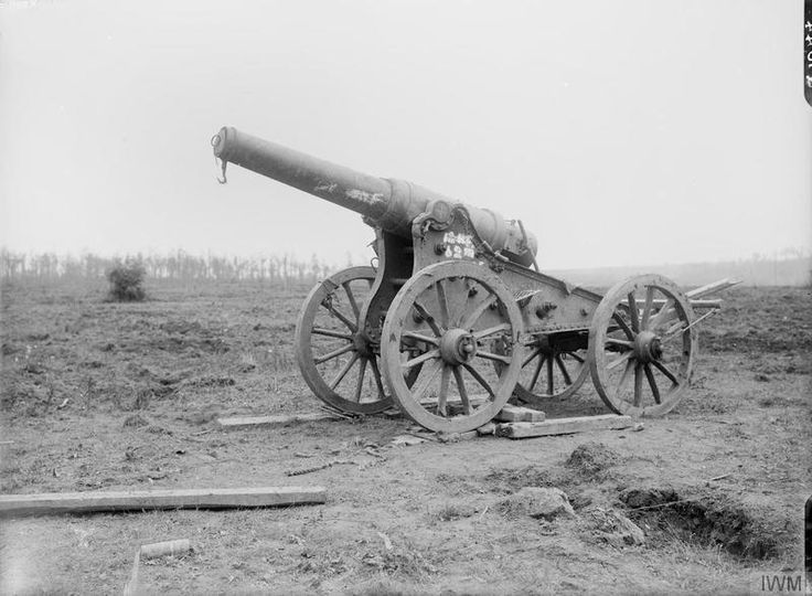 """Identified by the IWM as """"Captured 15 cm (150 mm) Ringkanone 92 German gun near Mametz Wood, 10th August 1916."""" However, the 15cm Ringkanone M92 had a much longer barrel and a different carriage. This is more likely a Russian Obukhov 152mm (120 pood) Fortress Gun M77 on a siege carriage, captured by the Germans on the Eastern Front and put into use with Landwehr Fussartillerie units. (3 of 4 photos)"""