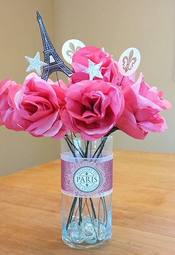 Finished DIY vase centerpiece using paris printables. Learn how to create this centerpiece to use with any theme at http://sparklerparties.com/diy/diy-centerpiece-on-a-budget/
