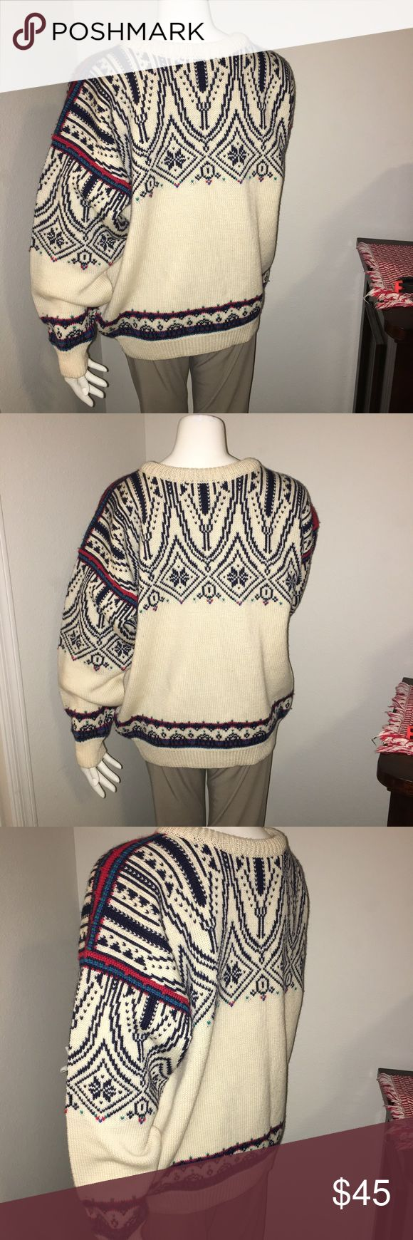 "Mens vintage LS wool sweater skandia of veil sz: L Thank you for viewing my listing, for sale is a men's, vintage, 100% wool, light brown, blue, and red, longsleeve, sweater.  Item is in great condition with no rips or stains.  Brand: skandia of veil - dale of norway Sz: L  If you have any questions or would like additional photos please feel free to ask.  From under one arm to under the other measures appx 25"" from the top of the shoulder to the bottom of the sweater measures appx 28""…"