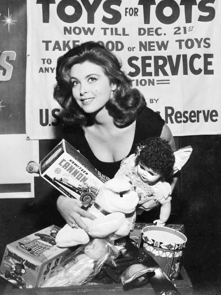 Tina Louise (Ginger on Gilligan's Island) working a Toys for Tots campaign in the early 60s