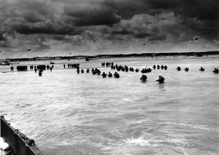U.S. reinforcements wade through the surf as they land at Normandy in the days following the Allies' June 1944, D-Day invasion of France. (A...