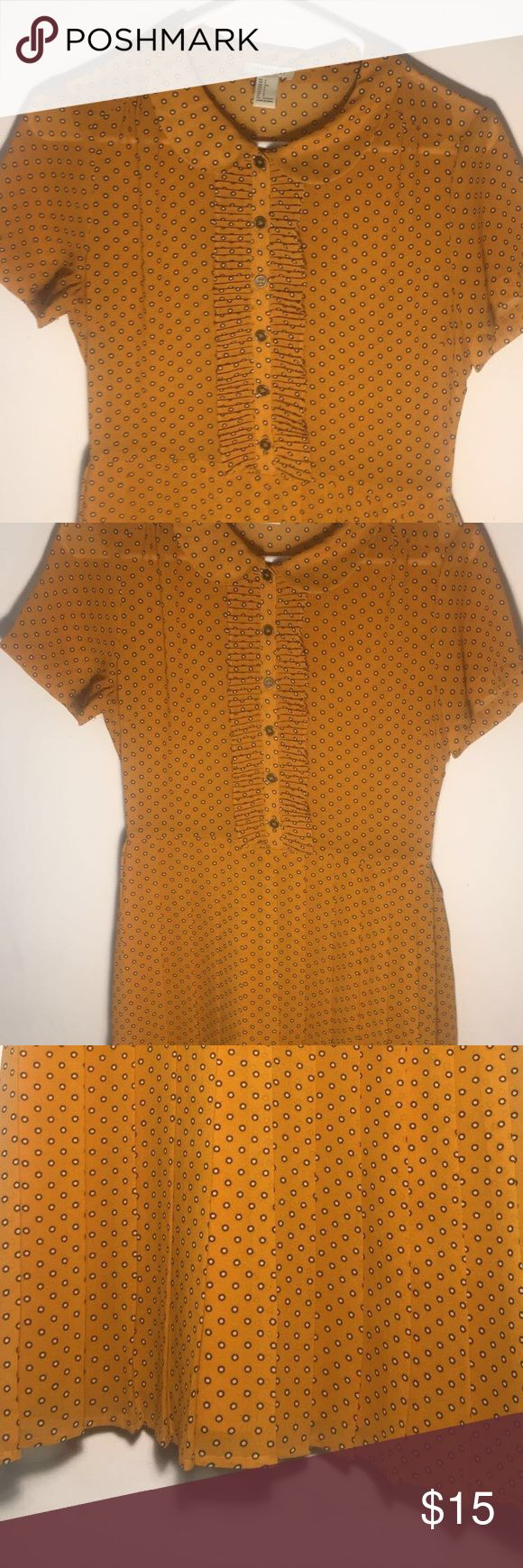Peter Pan Collar Marigold Dress Pleated dress with Peter Pan collar. Included zipper on the side. Detailed with dark gold buttons and black/white polka dots. Lightly warn. Easy to wear formally or casually! Forever 21 Dresses