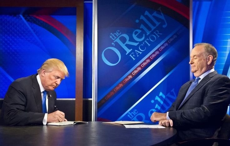 "Republican presidential candidate Donald Trump, left, signs his book for Bill O'Reilly, right, during his appearance on Fox's news talk show ""The O'Reilly Factor."""