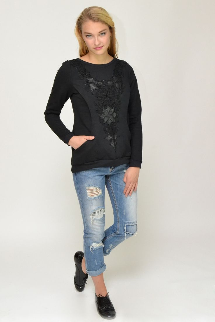 Black sweatshirt top with intricate lace and leatherette detail at front and large side pockets. Long sleeves.