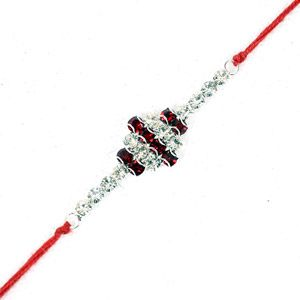 Giftblooms.com brings to you a wide collection of Rakhis for the occasion of Raksha Bandhan. This particular Rakhi is very chic in appearance. It is totally made up of white and maroon stones. Your brother can also wear this as a bracelet on his hand. He will be really enthralled to get this along with other Rakhi to India.