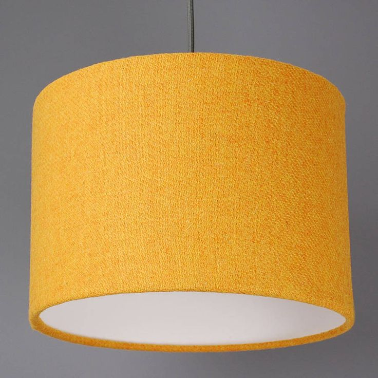 Imagine this with cool grey walls... A stunning lampshade handmade with Harris Tweed.Available in a choice of colours, and designs, please take a look at our other products.The Harris Tweed is woven by hand in the outer hebrides and each shade is finished with the famous Orb mark label. Made using a 42mm euro ring fitting with an adaptor also included for the 29mm UK fitting. Can be used on both ceiling fittings and bases.