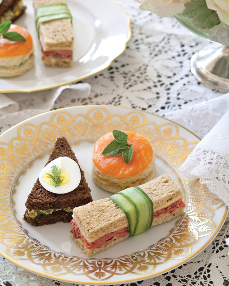 Trio of Tea Sandwiches - A plate of distinctively shaped sandwiches creates a hearty mix of options that will satisfy late-afternoon appetites. RECIPES for Roast Beef Tea Sandwiches,  Egg-and-Olive Salad on Pumpernickel Bread, and Round Smoked-Salmon Tea Sandwiches / Victoria Mag