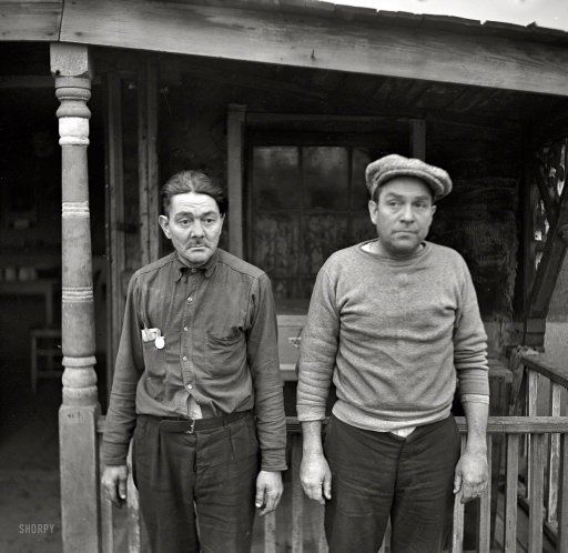 January 1937. Ottawa, Illinois. Two types living along the waterfront. Photo by Russell Lee for the Resettlement Administration