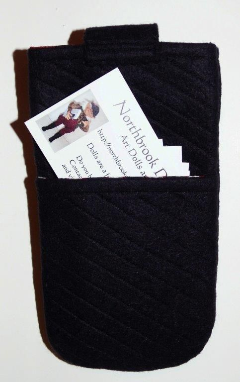 The back of the phone cozy has a handy little pocket for my business cards/ ear buds or other.