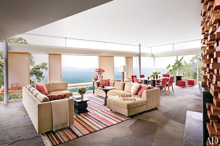 he living area is furnished with sectional sofas custom designed by Jorge Rosso and upholstered in a Brunschwig