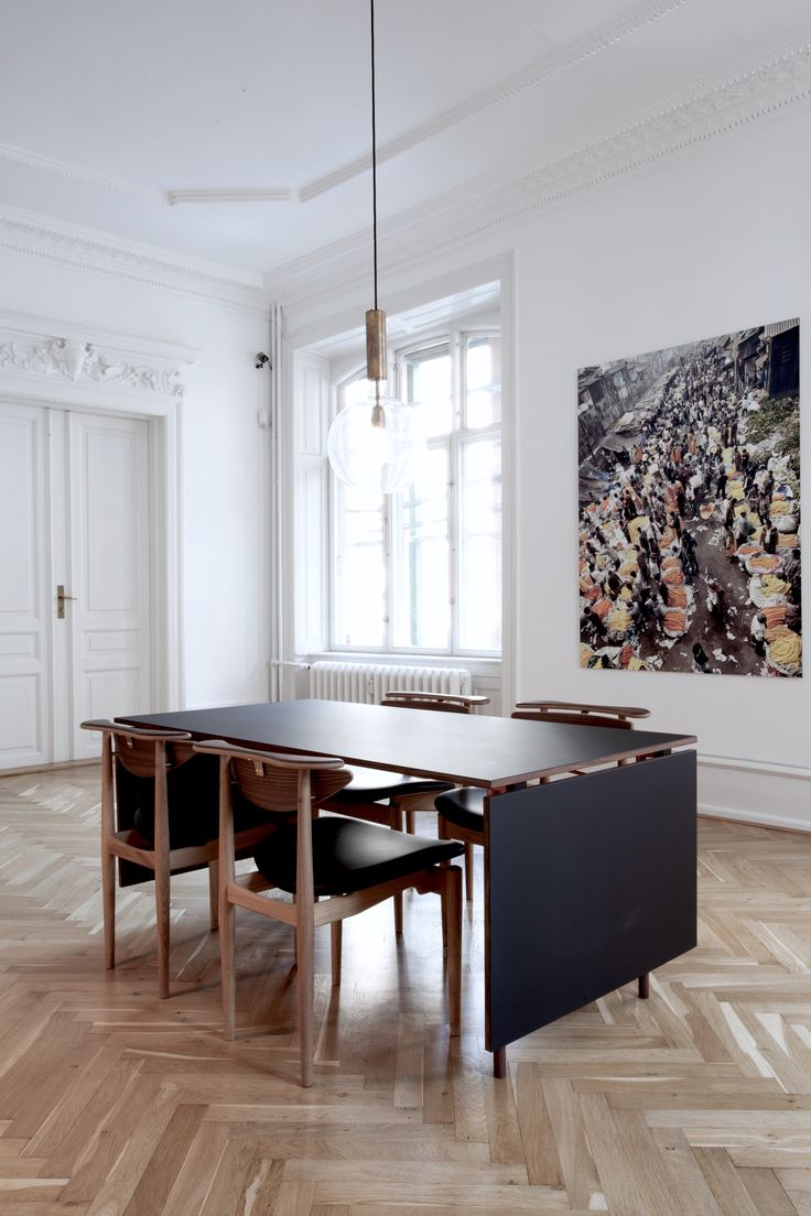 Stunning dining room with oak herring bone floor. Danish mid-century modern furniture designed by Finn Juhl. The reading chair was designed in 1953 and is now manufactured by Onecollection.