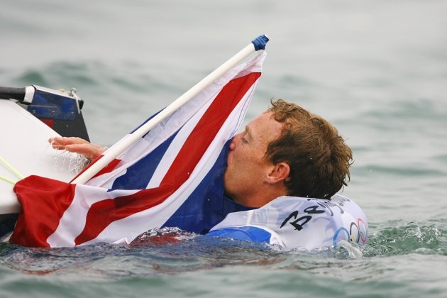 Inspirational Moments: Olympic celebrations - QINGDAO, CHINA - AUGUST 19: Paul Goodison of Great Britain celebrates overall victory in the Laser class event following the medal race held at the Qingdao Olympic Sailing Center during day 11 of the Beijing 2008 Olympic Games on August 19, 2008 in Qingdao, China. (Photo by Clive Mason/Getty Images)
