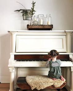 This little one playing piano.
