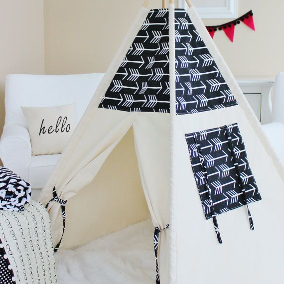 *IMPORTANT! Christmas delivery is NOT available for new orders! Christmas order books are closed. Black Arrows and Natural Canvas, Teepee, Play Tent, Play House, Nursery, Teepee Tent, Kids Teepee, Indoor  *AS SEEN IN ediTORIal – TORI SPELLING 2015 FALL MUST HAVES ▂▂▂▂▂▂▂▂▂▂▂▂▂▂▂▂▂▂▂▂ This listing is for BLACK AND WHITE ARROW ACCENT with roll up window  ⛺️ POLES ARE NOT INCLUDED. Details on purchasing poles are found below. ⛺️ Accessories & décor items are NOT included. ⛺️ Dimensions: Each…