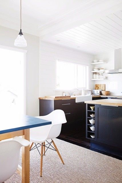 213: white & bright kitchen with dark lower cabinets, butcher block counters