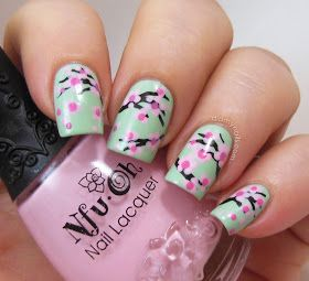 Cherry blossom nail art on mint manicure