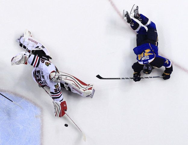 Remember how I was at this game? :)  St. Louis Blues' T.J. Oshie, right, scores past Chicago Blackhawks goalie Corey Crawford during the second period in Game 5 of a first-round NHL hockey playoff series Friday, April 25, 2014, in St. Louis. (AP Photo/Jeff Roberson)