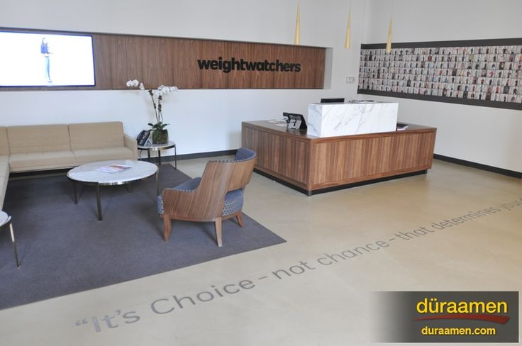 This concrete resurfacing even looks great in the offices of this corporate headquarters.