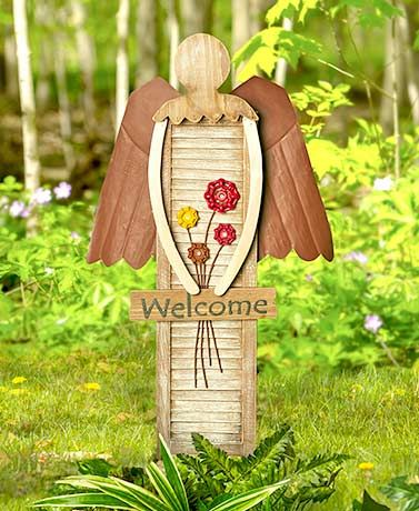 """This Garden Shutter Angel has a stylish, upcycled look that complements your DIY taste. She holds a sign that says """"Welcome"""" and has 4 flowers made from faucet"""