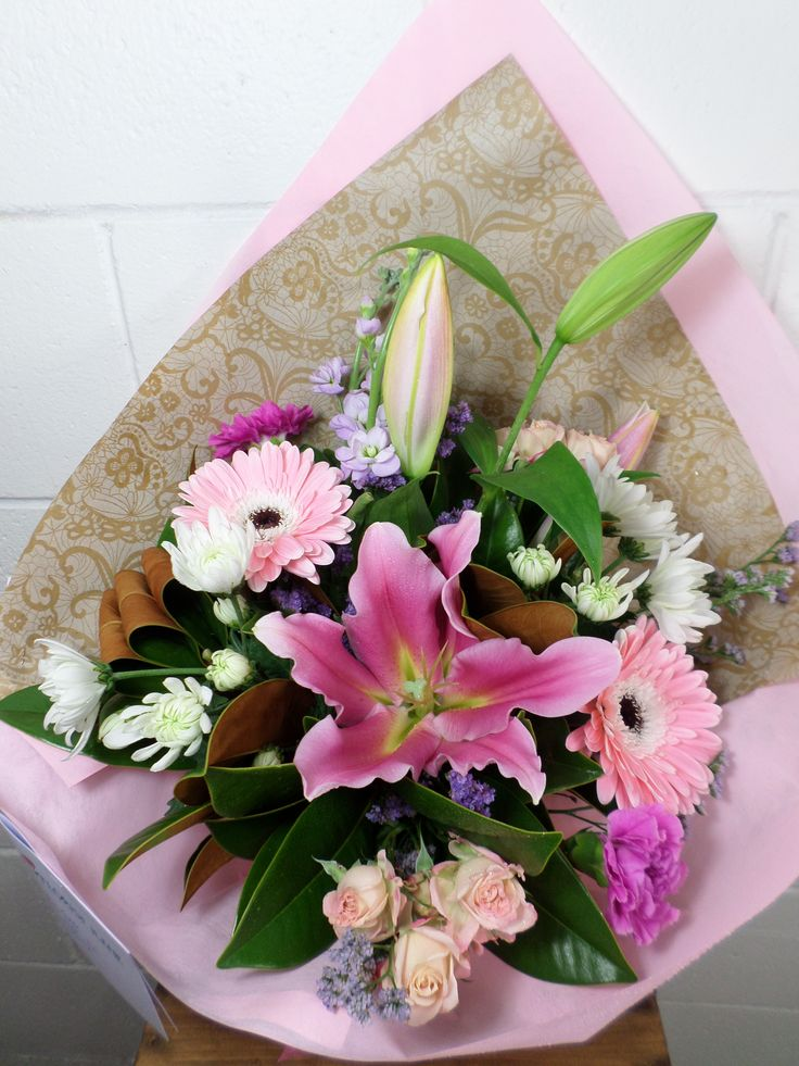 Bouquet made with Gerbera's, Lily's, Roses in lovely pink tones. Created by Florist ilene