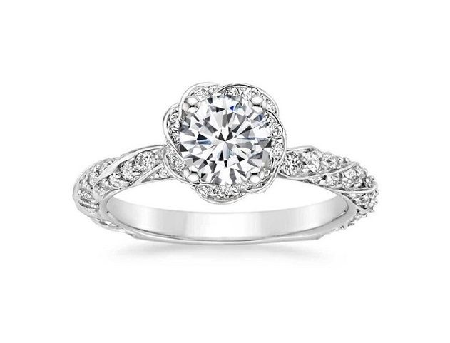 ''Cheope'' Amazin Vintage Design Diamond Engagement Ring Mesmerizing ribbons of metal and pavé diamonds twist around the band and center gem of this unique halo ring.