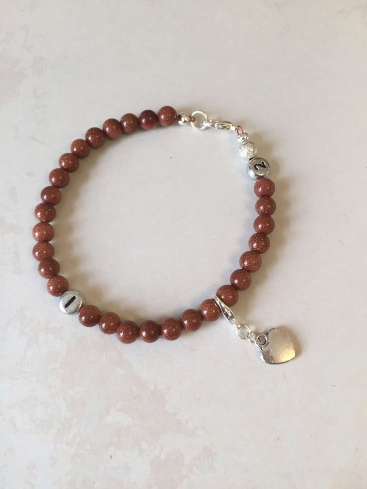 A personal favourite from my Etsy shop https://www.etsy.com/uk/listing/506518146/goldstone-weight-loss-tracker-bracelet