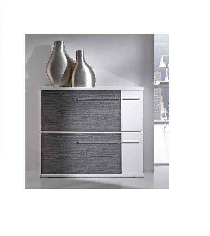 Aquí tienes este zapatero color ceniza y blanco, con 2 puertas de gran capacidad de almacenaje, de estilo moderno, que puedes adquirir en varios acabados en nuestra página web www.bianchimuebles.com.