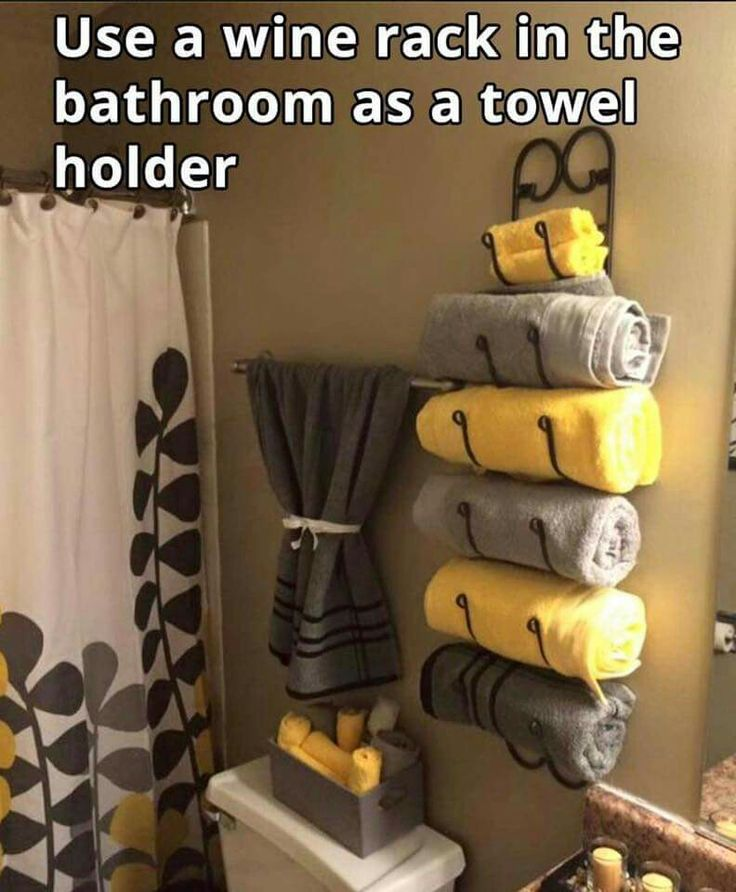 Awesome idea to use a wine rack as a towel rack in the bathroom                                                                                                                                                     More