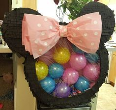 Minnie mouse piñata with balls or balloons