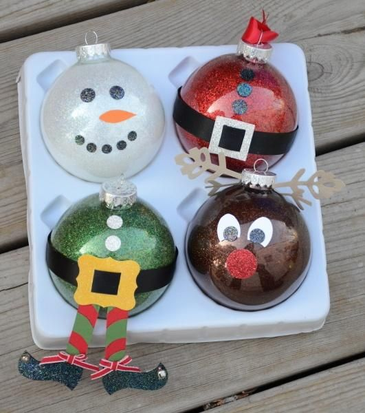This would be a great idea for a kids school christmas party gift. Glass ball ornaments - no directions, just pictures - though to get the glitter inside put one little squirt of clear floor wax inside the ornament and dump a bunch of glitter inside and shake with your finger over the hole until glitter sticks to sides of glass.