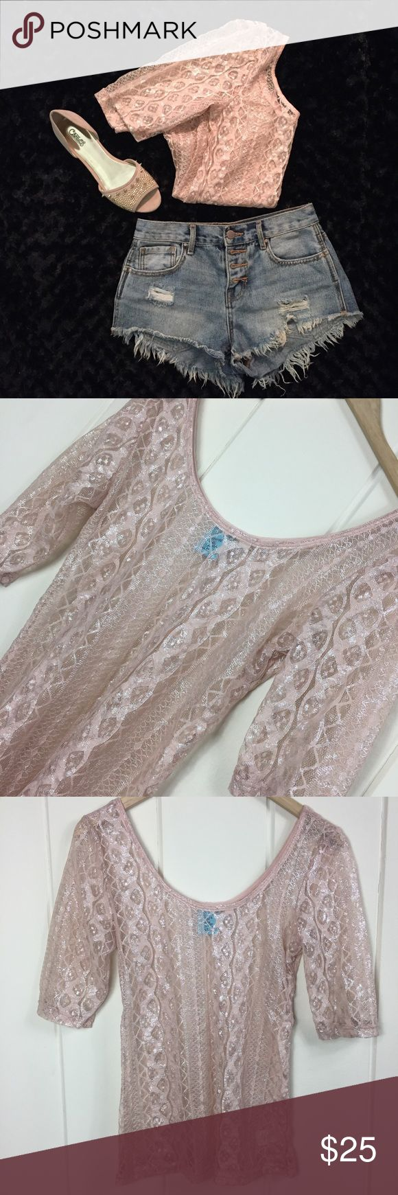 h.i.p. Sheer Lace 1/2 Sleeve Pink Silver Blouse 💕 One-of-a-kind gorgeous top! 😍 EUC (Excellent Used Condition)! 🙌🏼 No snags or pulls or stains! Would be perfect for a summer festival night or for the office (with a camisole underneath) or even as a sexy bikini cover up! Super sheer, beautiful and intricate lace design in a dusty pink with a silver sheen to it. Iridescent, so the fabric sometimes looks more/less pink, depending on the lighting. Size Medium. Has some stretch. Made in USA…