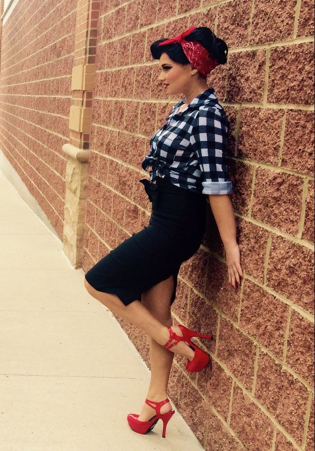 1940s inspired pin-up girl hair, makeup, and clothes. Black hair & skirt with plaid shirt. Red bandana, lips, and heels.
