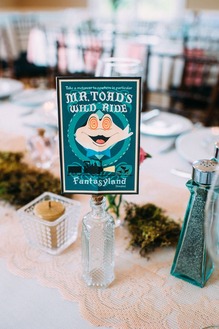 "Their Disney inspiration also made its way into the reception. The couple used vintage theme park posters to name every table atop a glass apothecary bottle. ""We wanted to incorporate Disney without going too crazy,"" Kim says. The accents served as a burst of nostalgia and a nod to their favorite rides."