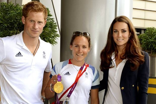 Duchess Kate and Prince Harry Visit Team GB House and pose with Champion Rower Sopie Hosking.