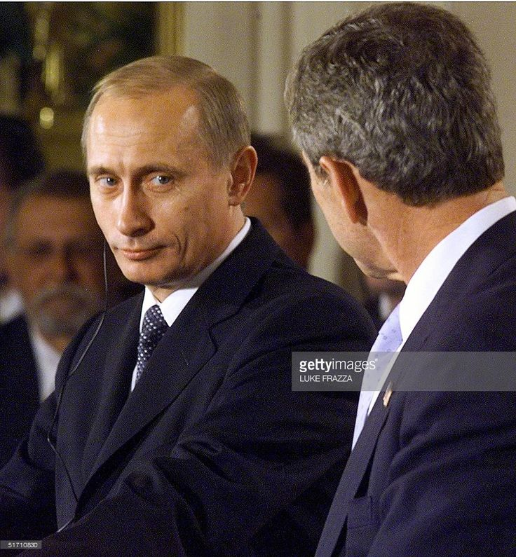 US President George W. Bush (R) and Russian President Vladimir Putin speak to reporters 13 November 2001 at the White House in Washington, DC after their meeting there. Bush announced at the joint press conference with Putin that he will cut the US nuclear arsenal to between 1,700-2,200 weapons within the next decade. AFP PHOTO/Luke FRAZZA
