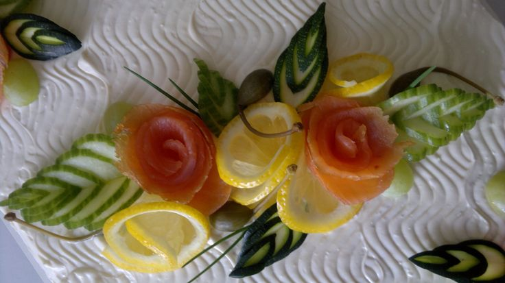 Decorations for a salmon sandwich cake. Leafs from cucumber and zucchini.