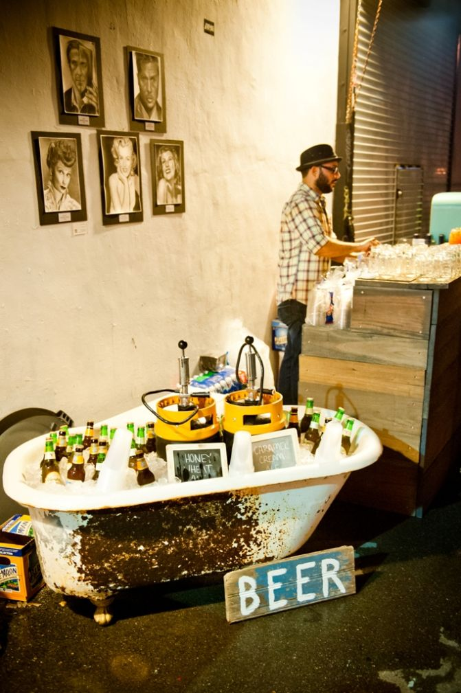 Beer displayed in a vintage bathtub.. adorbs!
