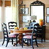 Break Up Sets  Mix and match furniture by relocating pieces from different spaces. In the casual breakfast nook, a hand-me-down table is paired with chairs that originally came with the dining room table. An outdated yard sale chest was painted black to match the chairs. Designer fabric snagged from a remnant bin was used to create the zippy curtains that add character to the neutral space.
