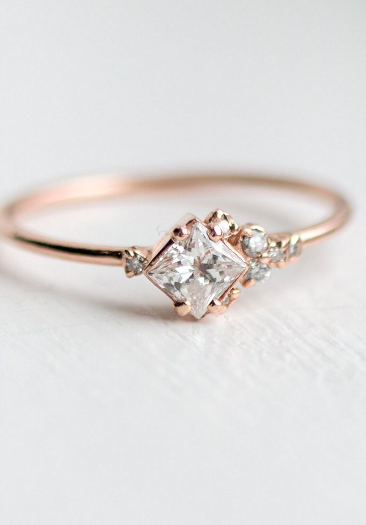 A Princess Cut White Diamond Sits Among A Cluster Of Sparkling White  Diamonds In This Airy Light Gold Ring. The Slim Smooth Band Is Delicate And  Feminine.