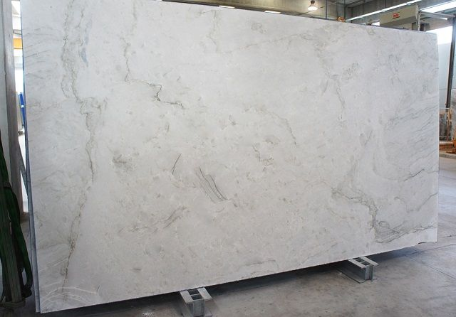 The Amazing Tones Of Tahiti Quartzite Seen In Slab Form Here At Boston Granite Exchange Quartzite Countertops White Granite Countertops Countertops