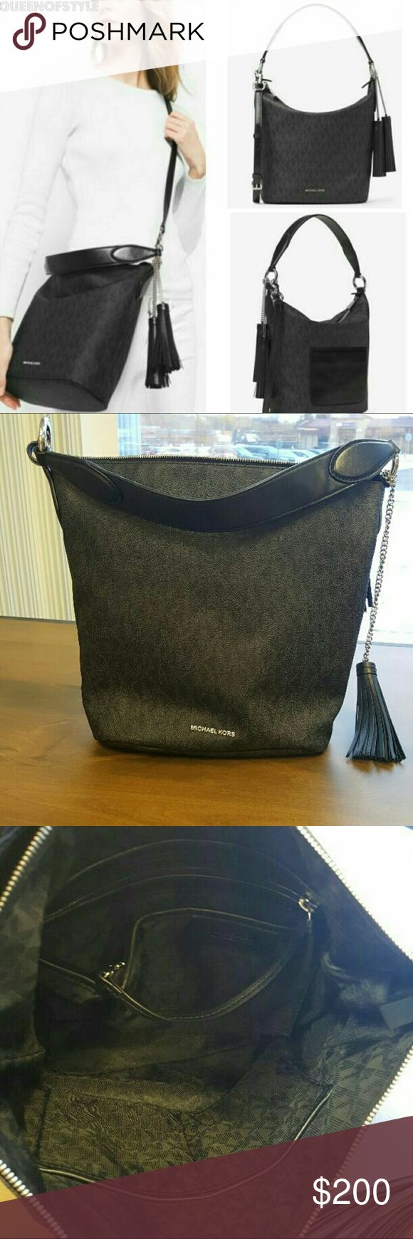 Michael Kors handbag The long strap is missing and the other problem with it is the stitches came off where I'm holding on the picture the last picture. There is no scratches or stains the handbag was a customer return they returned it back in 4 days and kept the long strap.  It's 100% authentic Original price  $376  MK signature PVC  zip top closure  silver-tone hardware exterior back slip pocket polyester lining  zip pocket, 3 open pockets, phone pocket and dog clip inside  approx. 14 x 11…
