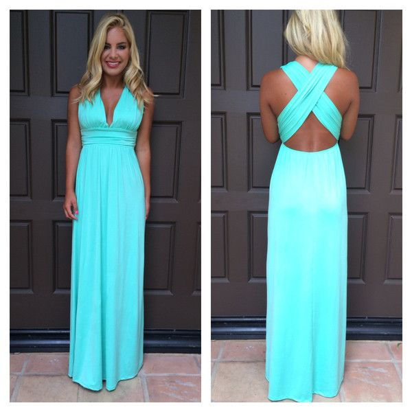 This dress features cross back straps and an elasticated waist.