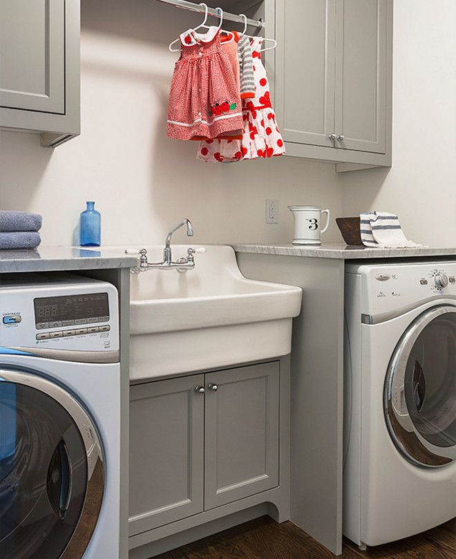 Laundry Room With Grey Cabinets Vintage Style Sink And Clothes Rod