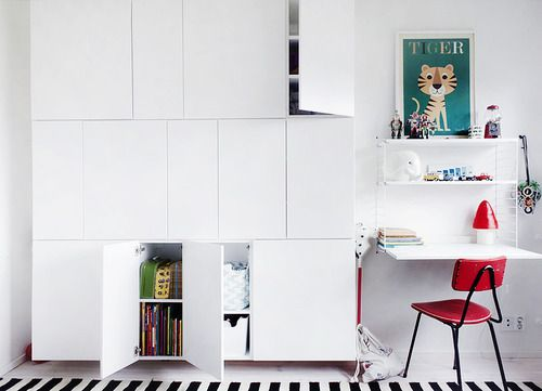 Hello PRETTY storage!  Weekday Carnival's genius Ikea Hack  for their kids room  - they bought 35cm kitchen cabinets and mounted them this way.  (and gorgeous string shelving next to it ;)