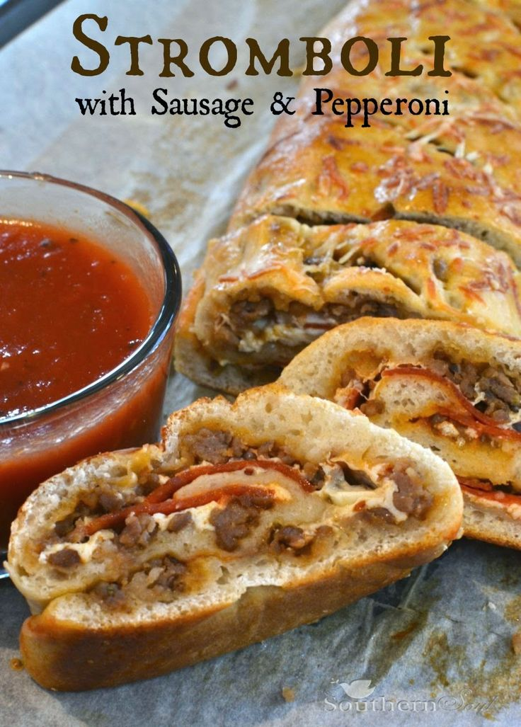 Sausage & Pepperoni Stromboli recipe | Italian sausage, pepperoni, gooey cheese rolled up and baked to golden brown - it's family favorite comfort food!