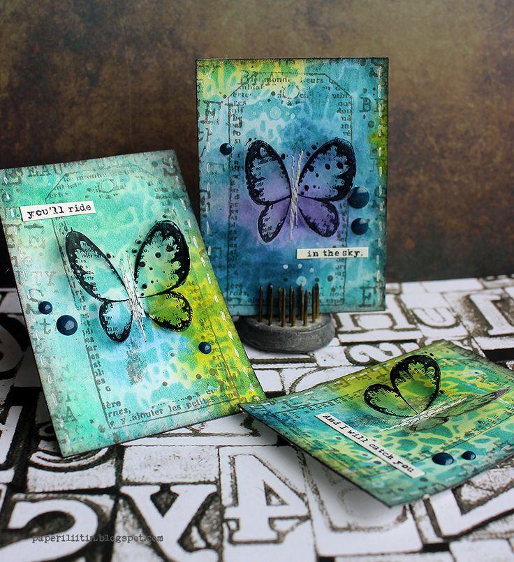 Riikka Kovasin: ATCs; Carabelle Studios Believe in Magic by Zorrotte; Ecriture à la plume by Ana Bondu stencil; Distress Inks; Leafs by Birgit Koopsen (text); acetate (for stamping the butterflies)