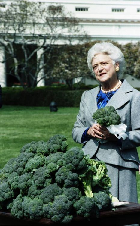 Mrs. Bush meets broccoli growers who present her with three crates of broccoli on the South Lawn, March 26, 1990. -from the George Bush Library