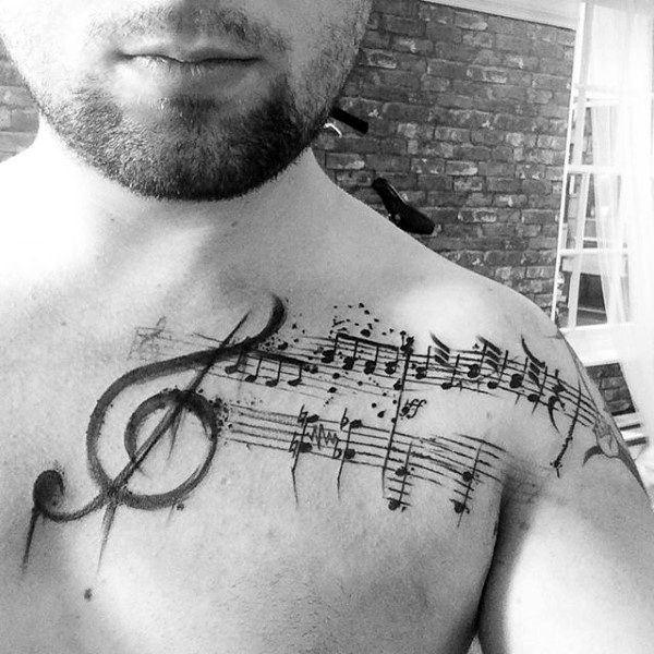 Guy With Musical Clef Tattoo On Shoulder