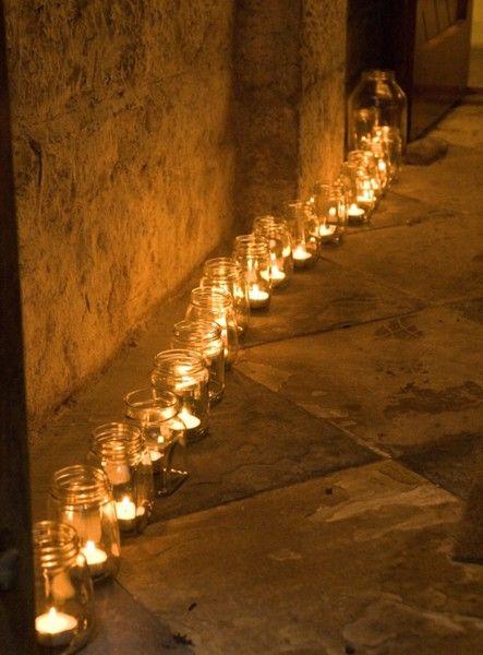 Large tealights in Mason Jars....beautiful, simple, budget friendly way to line a walkway